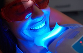 woman getting her teeth whitening in-office